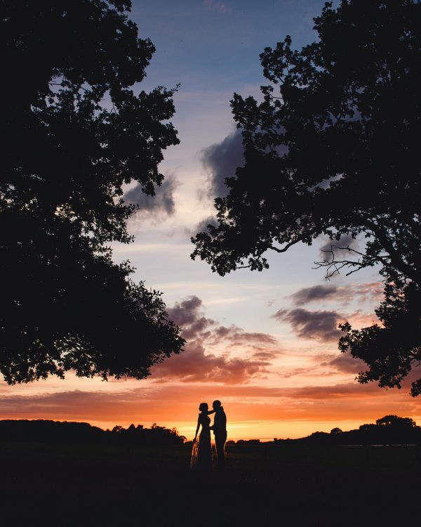 sam gibson wedding couple at sunset