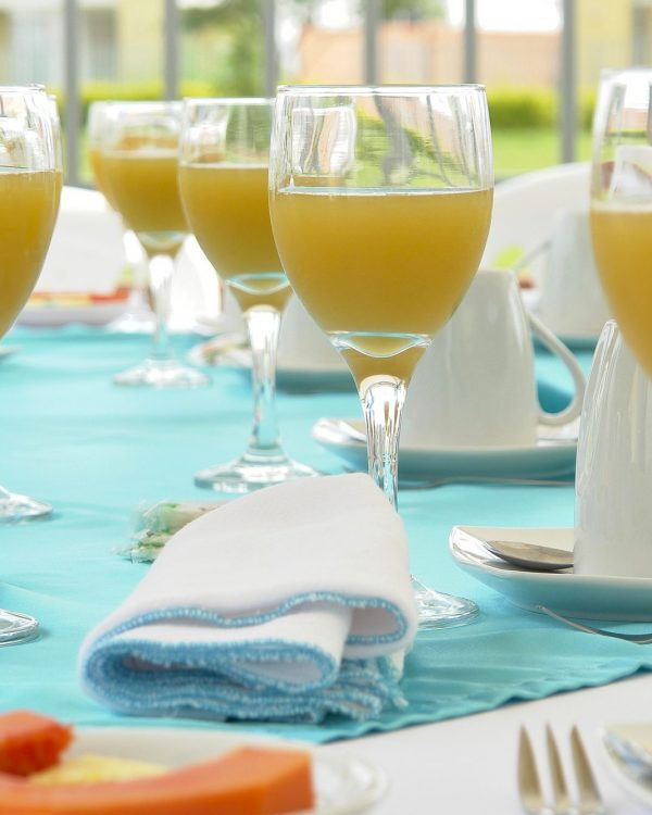 orange juice in glasses on table