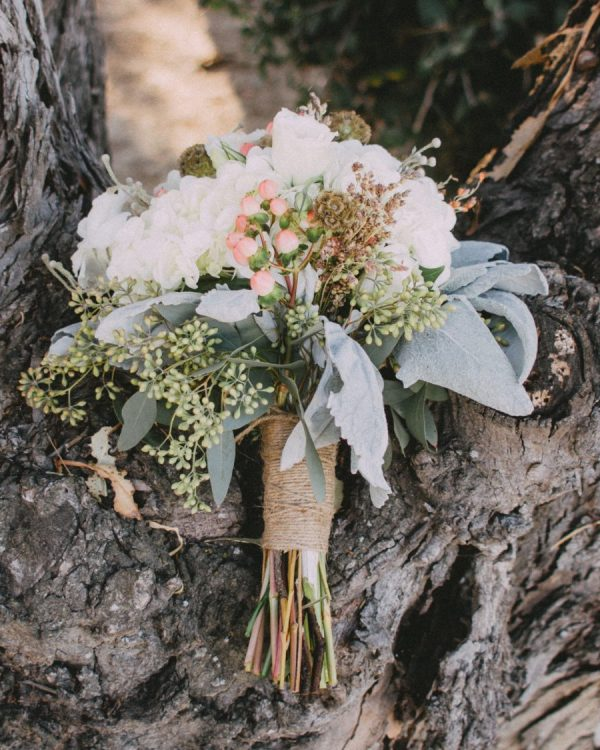 rustic bouquet on tree trunk