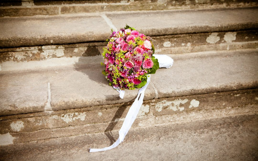 pink wedding bouquet on stone steps