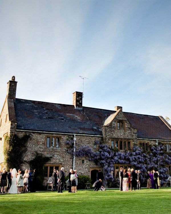 country manor with wedding party on lawn