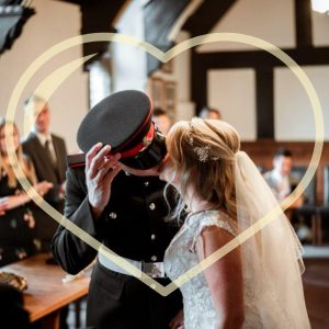 military wedding kiss in tudor style room
