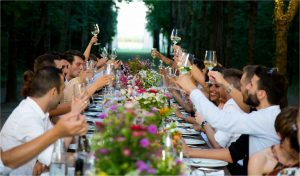 wedding party dining in wooded avenue