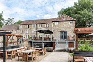 stone mill building with outside seating area