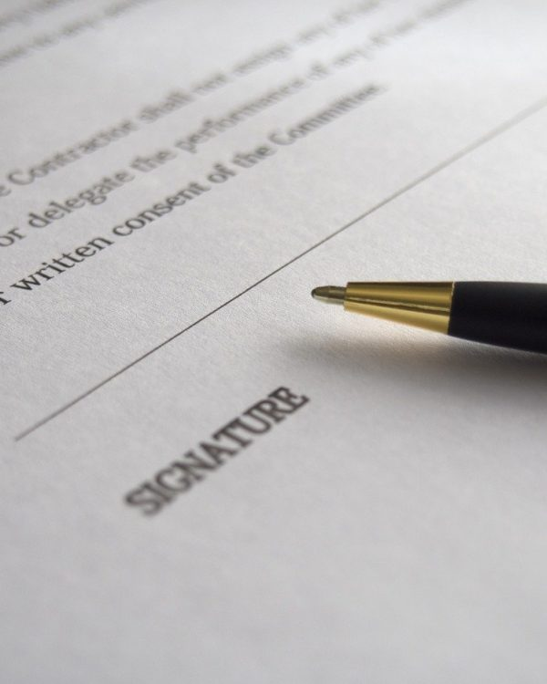 pen on contract paperwork