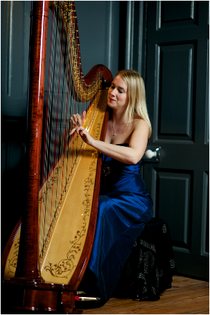 woman in blue dress playing large harp