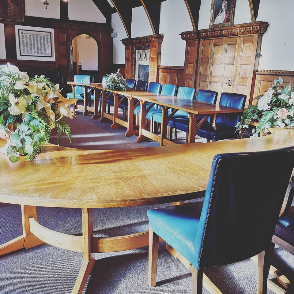 image of tudor ceremony room with curved oak table and blue leather chairs