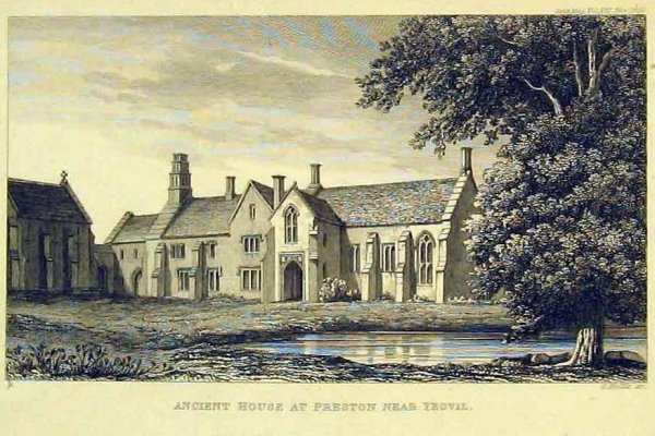 black and white etching on a postcard of medieval manor building dating from victorian era